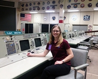 Julie Read poses for a photo in a NASA facility.