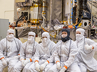Ben Bryan (second from right) and his team in the OSIRIS-REx assembly and test room. (Photo - Bryan)