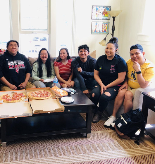 students gather to have pizza in native center