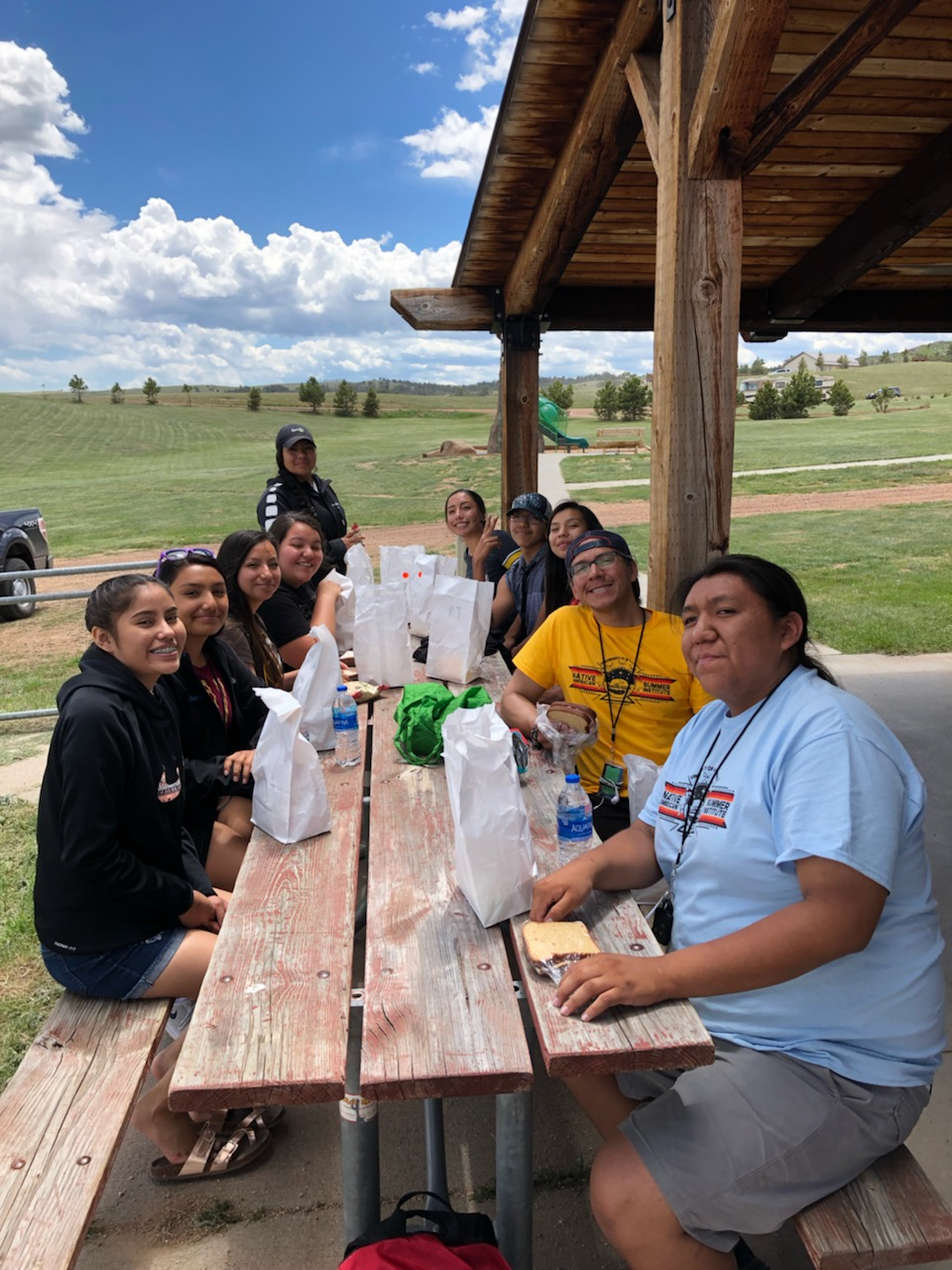 students have lunch outside in wyoming summer weather
