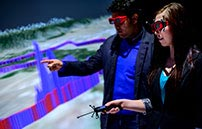 Thumbnail for youtube video two people viewing images in the 3D cave
