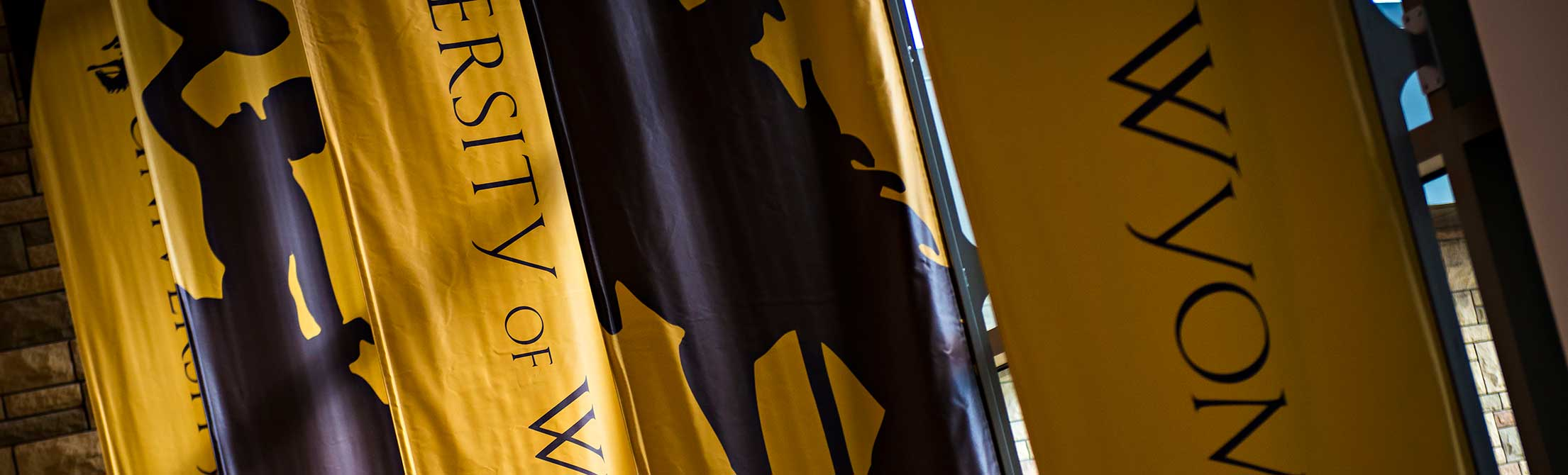 University of Wyoming gold banners in the Gateway Center on campus