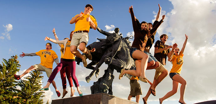 Students jumping off of a statue in prexy's pasture