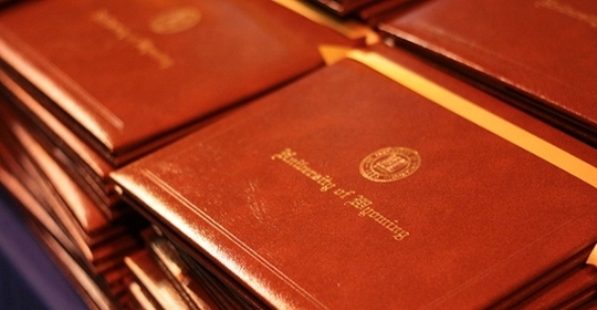Image of diplomas sitting on a table