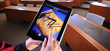 Image of an iPad in an empty classroom