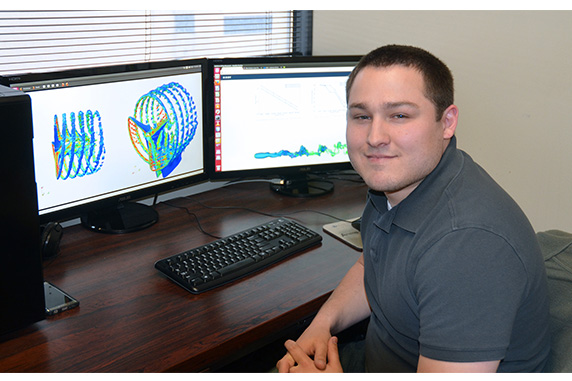 Andrew Kirby with a wind-farm model on his computer.