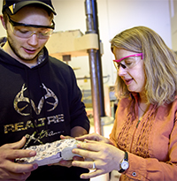 Jennifer Tanner Eisenhauer discusses concrete properties with a student.