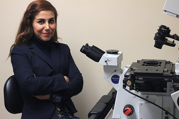 Ph.D. student Samira Masoudi poses for a portrait in her bioengineering lab.