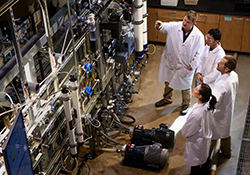 Members of Jon Brant's water research team at UW discuss filtration systems.