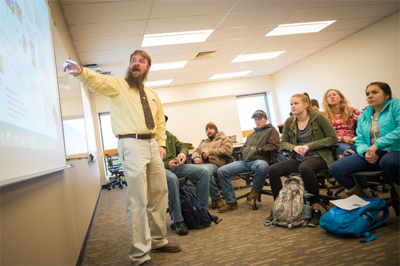 Ryan Kobbe explains concepts to his class in the College of Engineering and Applied Science.