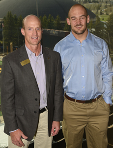 Tanner Harms and Randy Welniak pose for a photo at a year-end academic celebration.