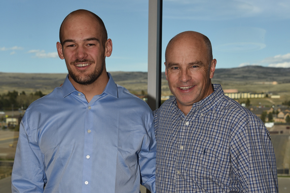 Tom Burman and Tanner Harms pose for a photo at a year-end academics celebration.