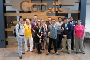Group photo of Silicon Valley Summit in front of Google logo