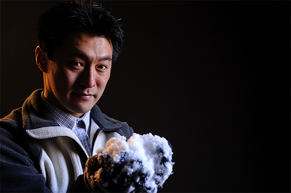 Noriaki Ohara poses with snow for his hydrology research.