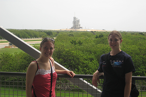 The Sandberg sisters pose for a photo at NASA Kennedy Space Center for a shuttle launch in 2011.
