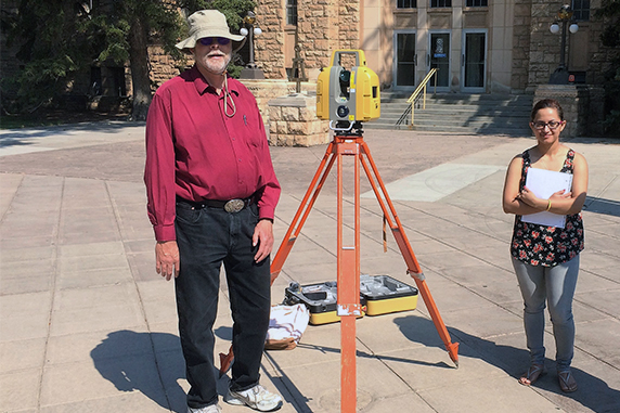 Mark Rehwaldt and graduate student Prapti Giri use a new all-terrain 3D scanner.