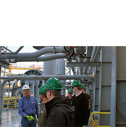 Group of petroleum engineering students tour oil rig