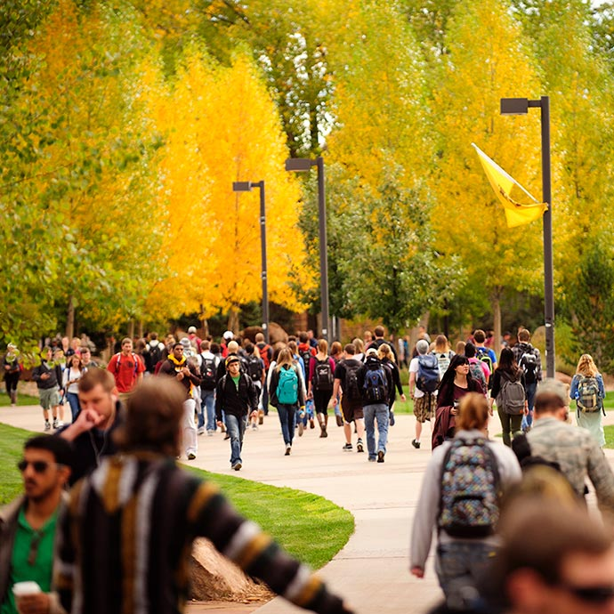 students walking on campus in autumn