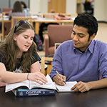 two students sit at a tutoring session