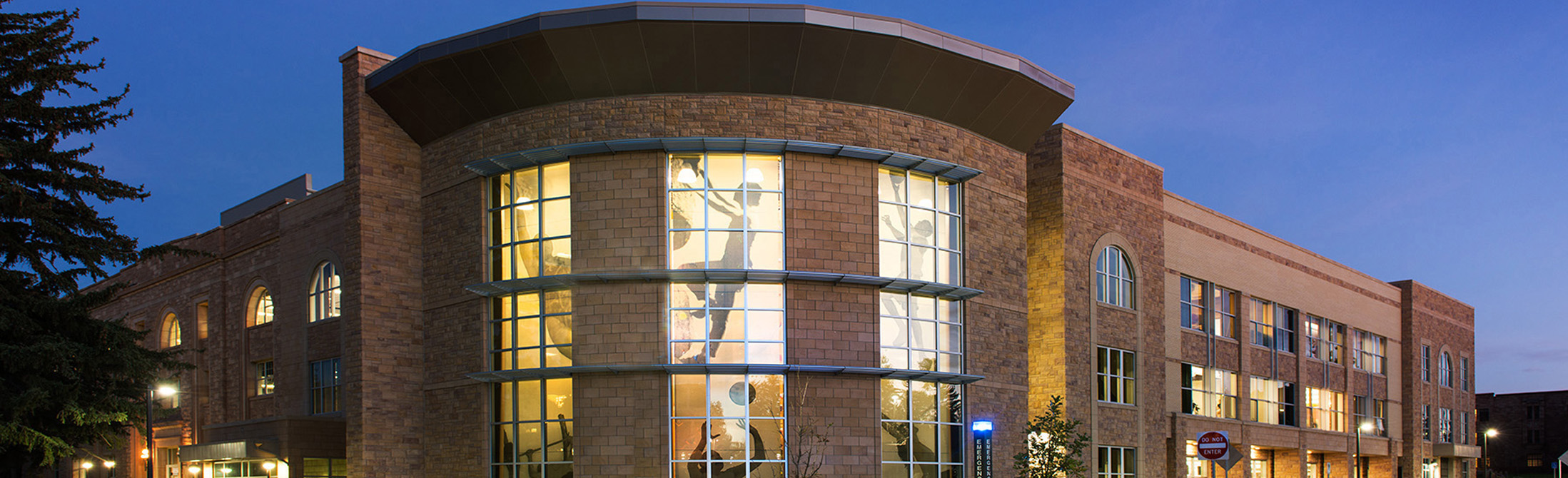 Evening exterior view of the half acre recreation and wellness center