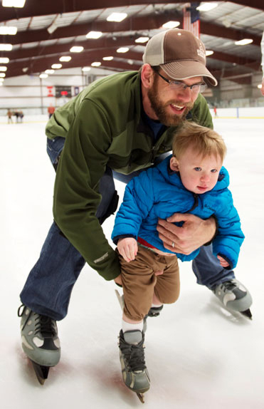 Man and son skating