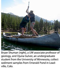 Bryan Shuman (right), a UW associate professor of geology, and Djuna Gulver, an undergraduate student from the University of Minnesota, collect sediment samples from Emerald Pond in Leadville, Colo.