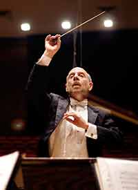 man in conducting orchestra