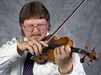 close up of man playing violin
