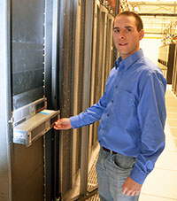 man standing in front of computer server