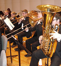 musicians with low brass instruments