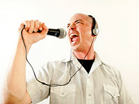 man holding up microphone and talking into it