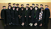 group photo of people in black caps and gowns