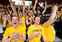 young men wearing UW tee-shirts in a crowd