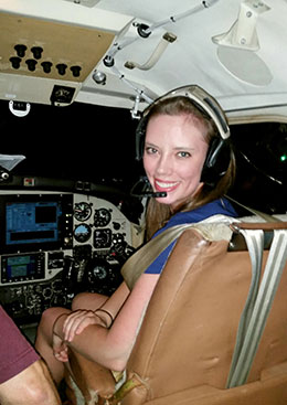 woman in the cockpit of an ainplane