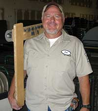 man holding a moving dolly over his shoulder