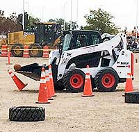 bobcat front-end loader scooping basketball off traffic cone