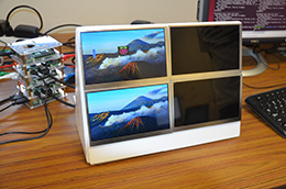 video display divided into four, with four small units behind