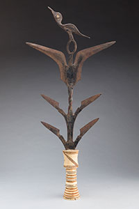 ceremonial knife with six branching blades and a stylized bird at the top