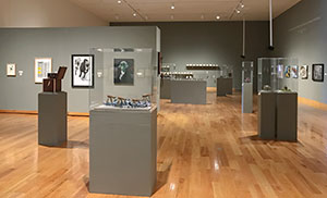 art gallery with exhibits placed around the floor and walls