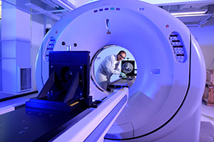 person using a CT scanner