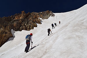 people climbing a snowy mountainside