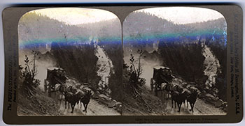stereoscope image of horses pulling a stagecoach through a canyon