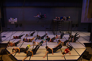 many people on a lying on a stage rehearsing a dance sequence