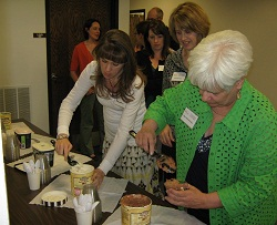 Participants help themselves to ice cream in honor of Shakespeare's birthday.