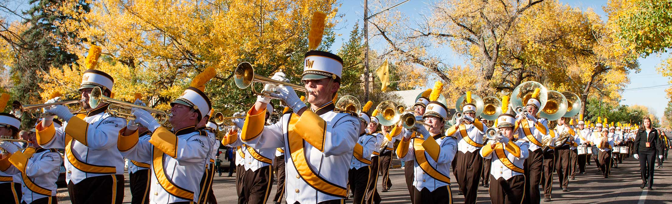 UW Marching band marching during a parade.