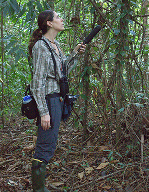 person in a jungle with a large microphone